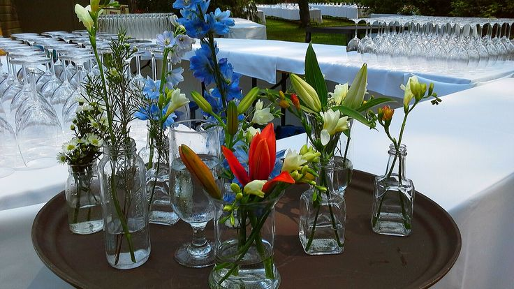 assorted vases with lilies, freesia, delphinium, waxflower and rosemary; design by Davis Floral Creations