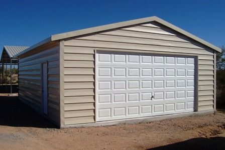 This prefab metal garage building is a fine example of our for Metal shiplap siding