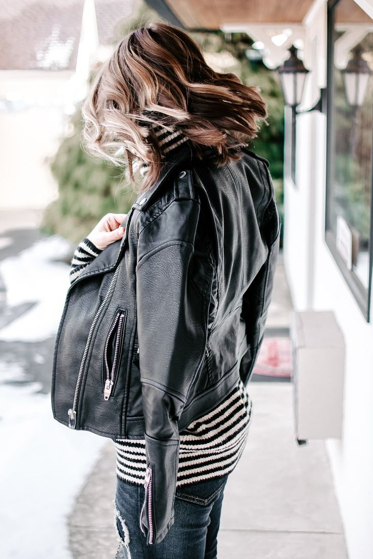 Leather moto jacket over an oversized striped turtleneck sweater and dark distressed denim for an edgy chic outfit. | Outfit ideas