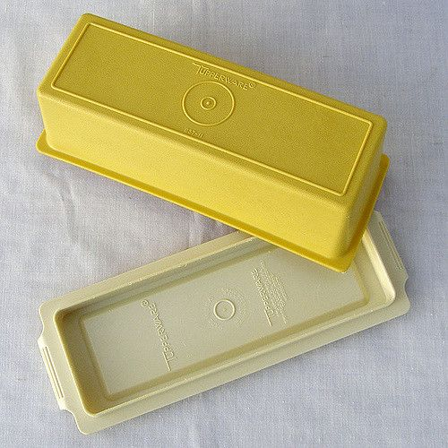 This Tupperware butter dish features a light yellow top and beige bottom. The lid snaps snugly to the base helping to preserve the flavor of the butter or margarine kept inside. The yellow top is in great vintage condition with only minor wear and the base is in good vintage condition with some scratches and nicks.  The lid states: * TUPPERWARE * 637-11 *  The base states: * TUPPERWARE * MADE IN U.S.A. * U.S. PAT 3.428.935: DES. 204.614, DES. 204.615 * TUPPERWARE * ORLANDO, FLORIDA, U.S.A…