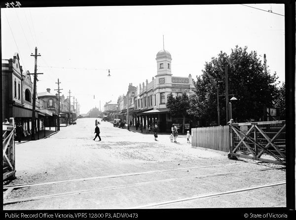 STREET SCENE MACAULAY ROAD KENSINGTON LOOKING WEST FROM RAILWAY GATES - Public Record Office Victoria