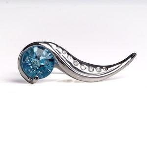 Round cut blue topaz set in a two finger ring design.  #bluetopaz #craftrevivaljewelers #jewelry #uniquering #gemstone #gemstonejewelry