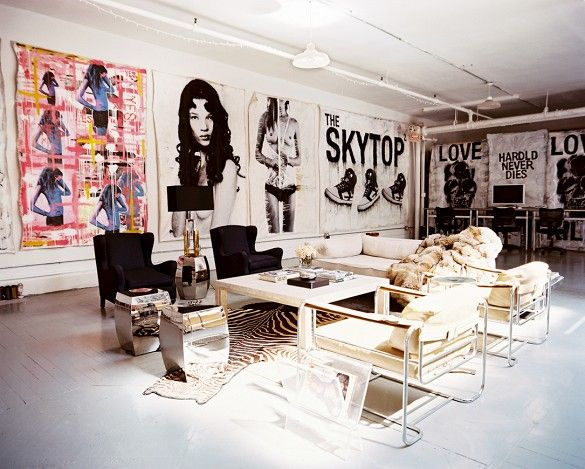 Seating area with large-scale art in open loft space.