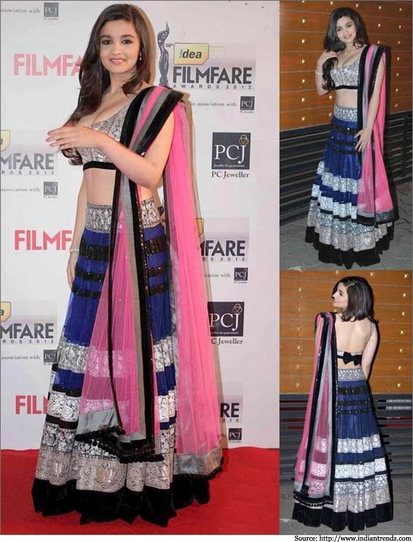 #Alia Bhatt wearing a very beautiful black and neon pink #Manish Malhotra lehenga with a stylishly backless #blouse design.