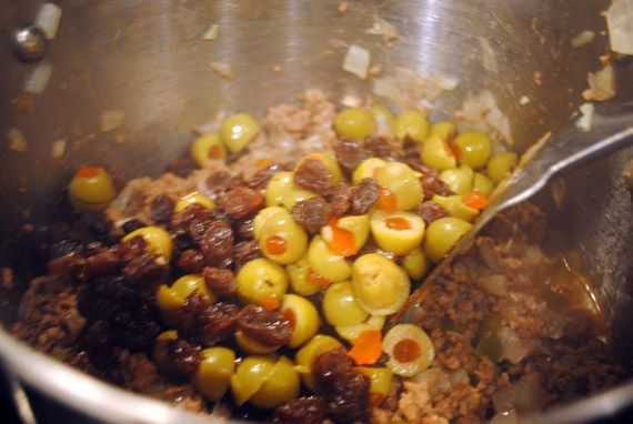 My neighbour introduced us to Picadillo, now it is in the rotation...mmmm...make some Frijoles Negro with it too and add some tumeric to your rice to make it a beautiful yellow.  YUM!