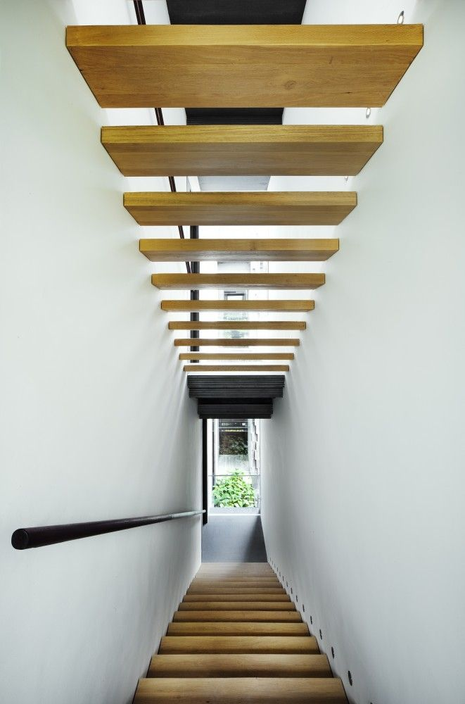 Nest House / WOHA  Narrow enclosed staircase, but with open treads and light at the end you wouldn't know it