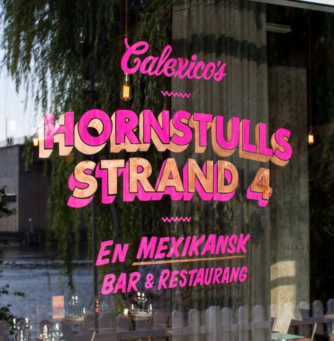 Calexico's shop front. Obsessed with neon pink and copper hand drawn and vintage type...