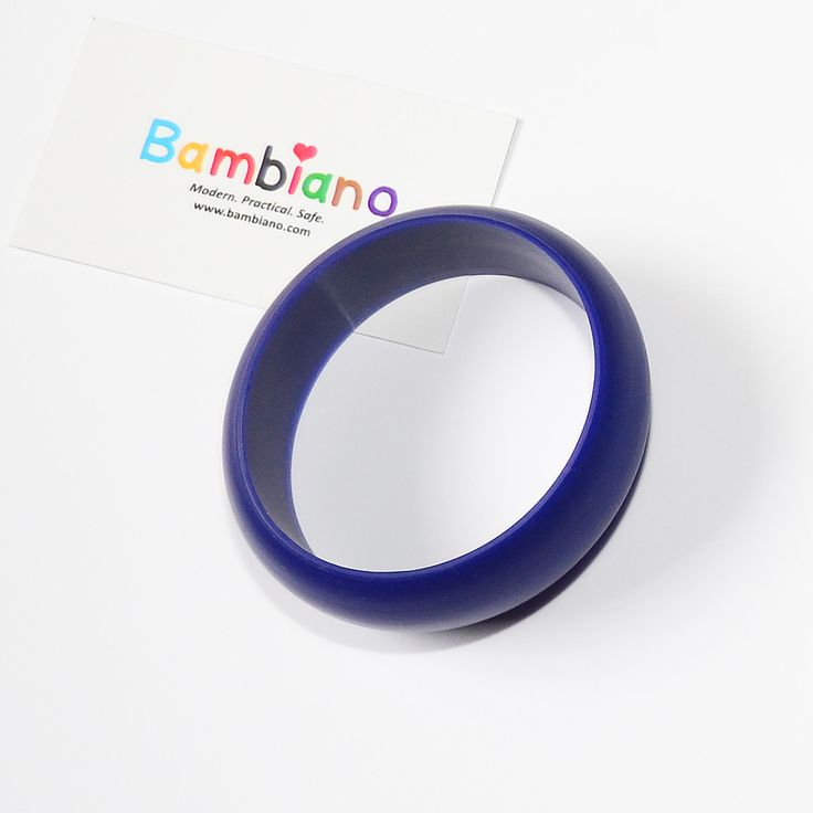 Bambiano Hoola Bangle in Navy Blue. Bambiano Bangles are made of 100% Food grade silicone. BPA free, Lead free and nontoxic. Fashionable for Mums and safe for teething babies to chew on. Bracelets are washable and soft on baby's gums. Shop at www.bambiano.com