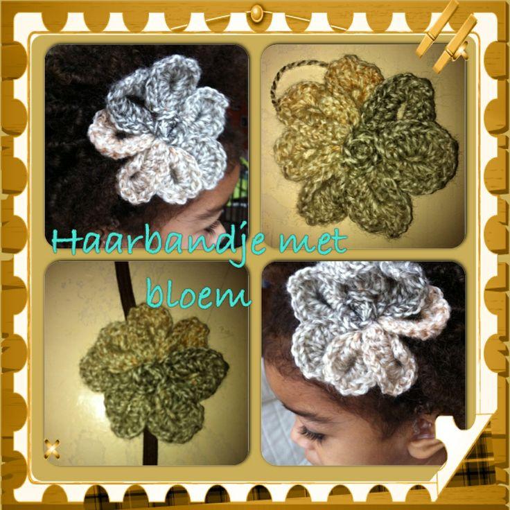 Haarbandje voor mijn dochter met een gehaakte bloem. #crochet flower.. Staat zoooo schattig bij haar donkerbruine afro-krullen ! <3