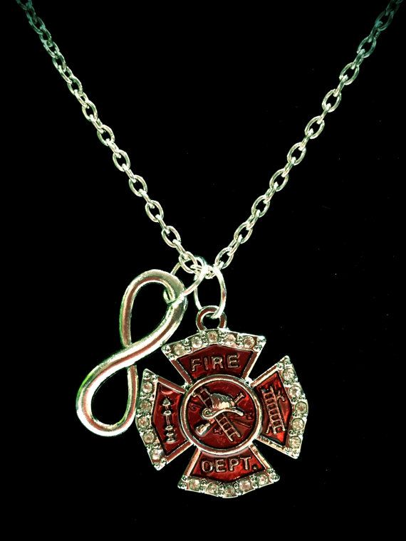 What a stunning necklace! Silver tone charms on 18 chain with lobster clasp. Maltese Cross is approx 1 and is red with crystal color rhinestones