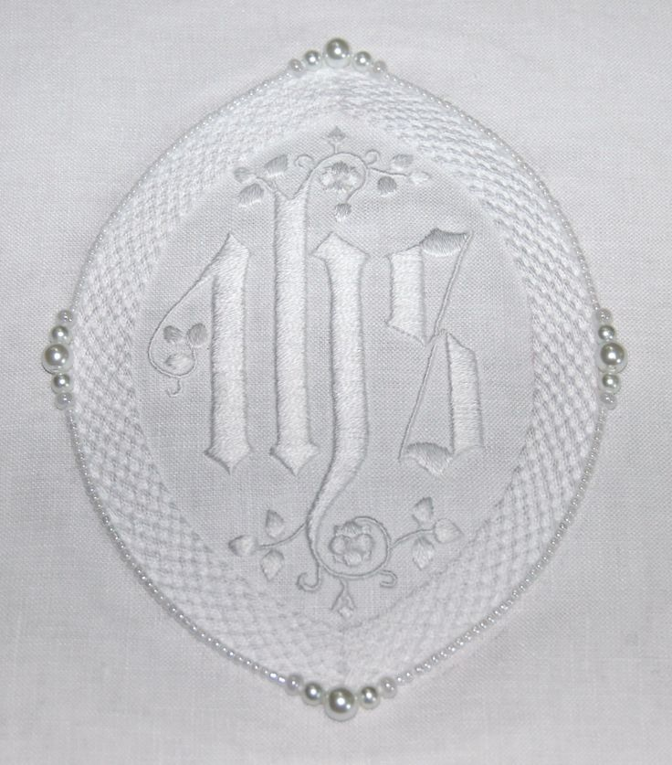 IHS Chalice pall; hand embroidered on 100% linen; satin stitched IHS in 2 strands of DMC B5200; white Sinfonia plaited crochet yarn couched with white sewing thread; edged with 6mm and 4mm glass pearls (Cousin) with 6/0 pearly glass beads (Beader's Paradise) and pearly seed beads #420 (Jane's Fiber and Beads); 10.21.17