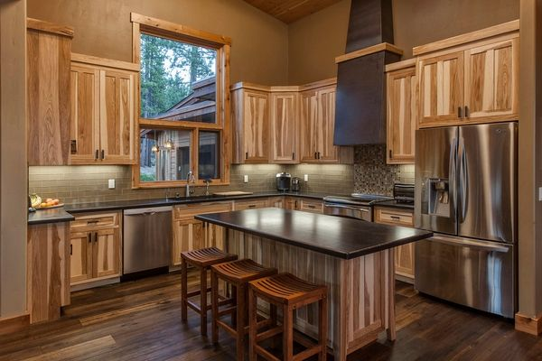 modern-kitchen hickory cabinets glass subway tile backsplash hardwood flooring