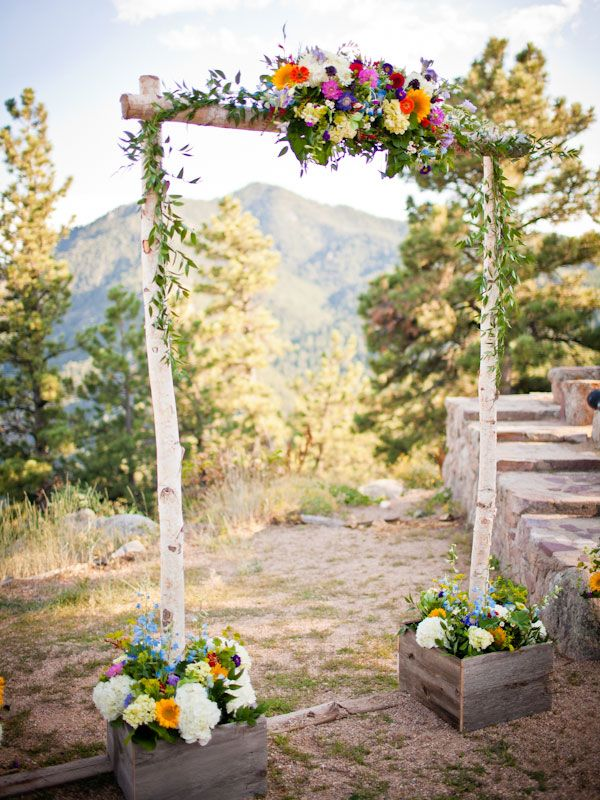 This simple, rustic ceremony arch perfectly complements a gorgeous natural backdrop.