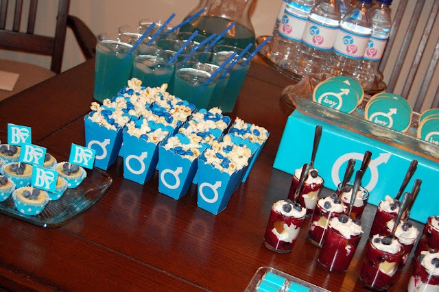 Gender reveal party blue food table