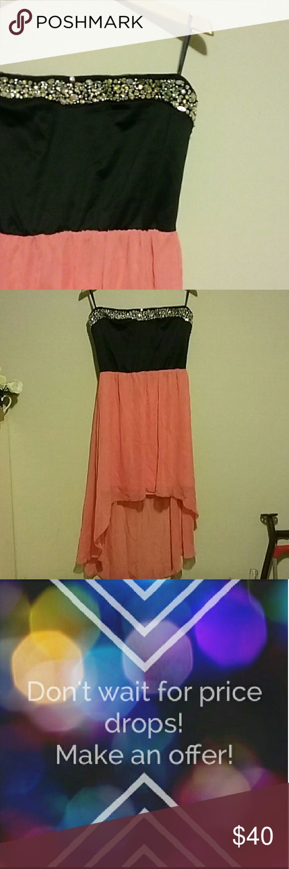 Hi-Lo Dress This beautiful dress has a black top with amazing rhinestone detail at the neck it is a strapless dress the bottom is coral and it's high low is lined and it is a size 3x it is from Deb Shops Deb Dresses High Low