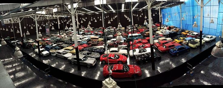 With half the building's floors and paint complete the cars have been moved in preparation for the second half! How many cars can you identify?