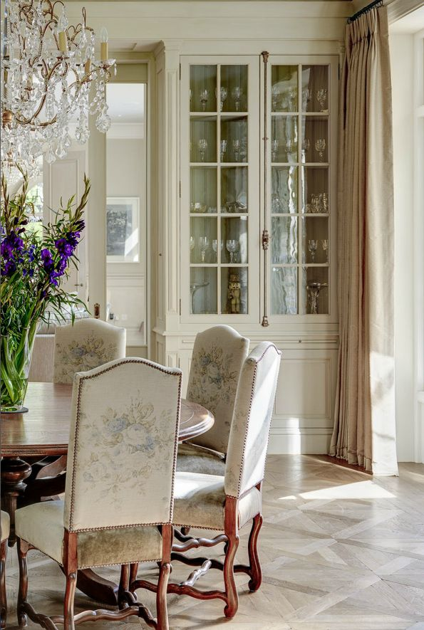 Formal Dining Room with antique chairs and chandelier with a bespoke hand-crafted dining table www.minniepeters.com