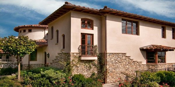 Small Home Exterior Design with Stone Wall Decorative Finish, Wood Framed Windows and Shrub Garden