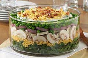 Majestic Layered Salad!  Spinach, mushrooms, peas, bacon, hardboiled eggs, shredded cheese, sour cream dressing