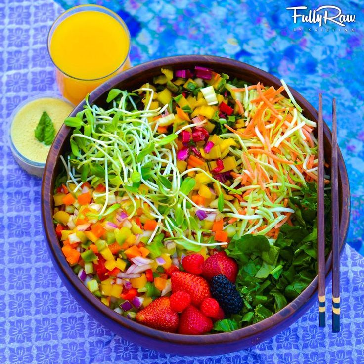 Crazy-Cool FullyRaw Rainbow Salad! Colorful diced bell peppers, Swiss chard stems, sprouts, shredded carrots/broccoli, and berries over dark leafies with a glass of fresh orange juice and orange sesame tahini mint dressing. EAT COOL, BE COOL.  Kristina Carrillo-Bucaram Rawfully Organic Co-op www.instagram.com/fullyrawkristina