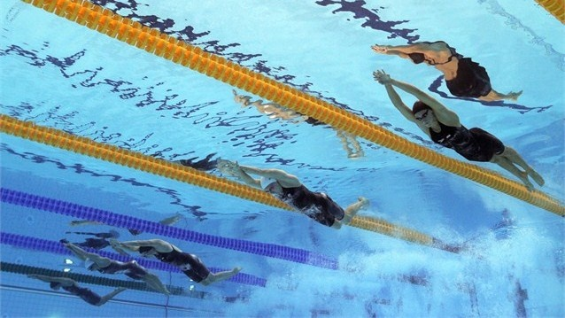 An underwater remote camera captures the women's 100m Butterfly