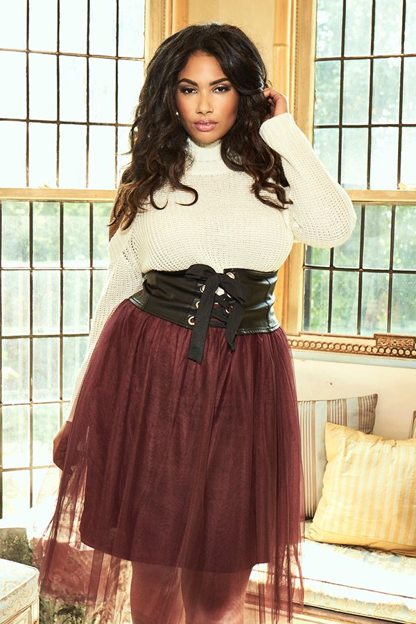 Add some softness to your attire with a long sleeve white turtleneck & a maroon tulle skirt.