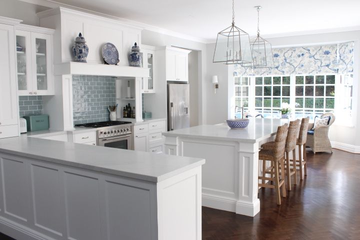 Marble and white Kitchen , nickel pendant light, blue subway tiles, marble bench top, Melinda Hartwright Interiors