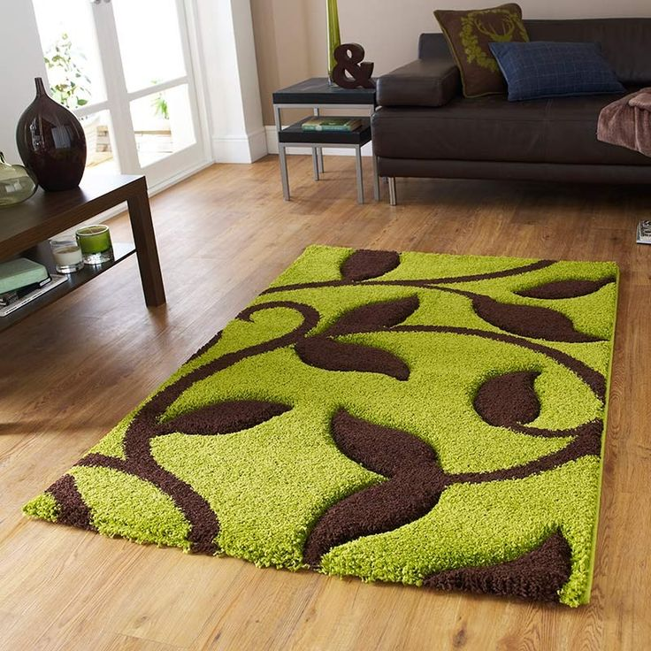 a rug for all seasons with a sweeping vine design in green