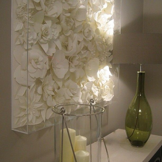 Spray paint fake flowers, glue to canvas. Super idea. Really chic.
