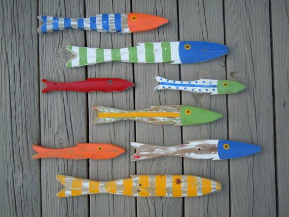 School of 8 Hand Painted Picket FISH Art Reclaimed Wood Beach Cottage Cabin Decor. $139.00, via Etsy.