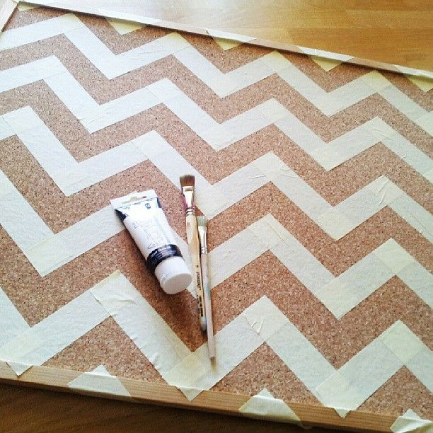 Tape a chevron design onto a cork board and paint over it for stylish and functional #dorm wall decor! #DIY