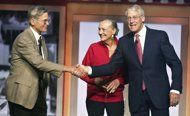 Jim Walton, left,, Alice Walton, center, and Robson Walton, right, greet each other during the beginning of the Walmart Stores Inc. sharehol...