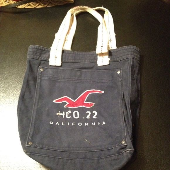 Hollister Tote Bag Navy blue Hollister tote bag with a large front pocket. Condition of wear is reflected in the low price! Hollister Bags Totes