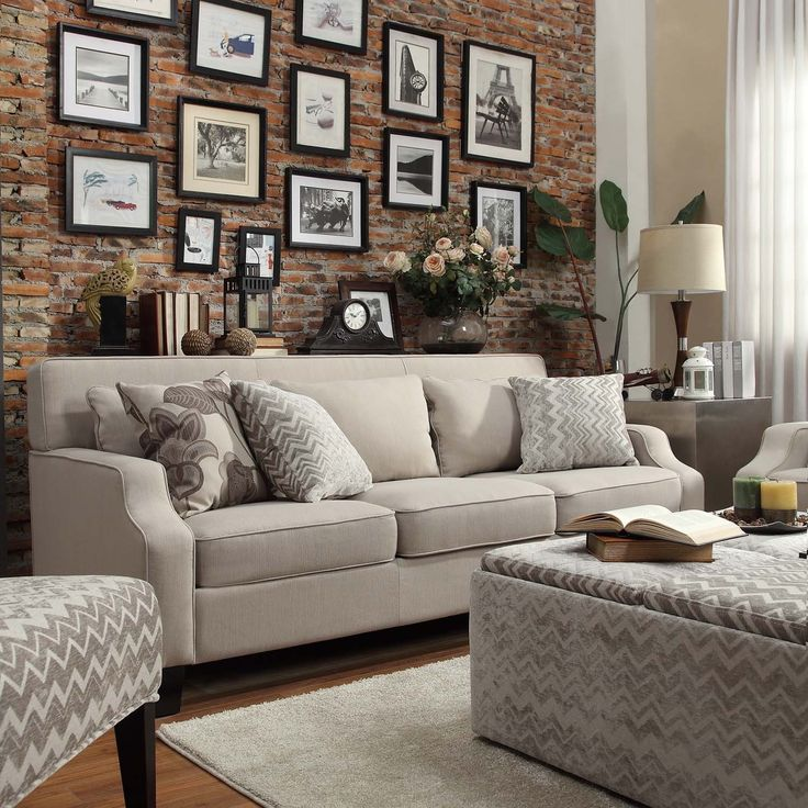 The beautiful Broadway grey upholstered sofa features clean lines and soft cushions for a comfortable and relaxing lounging experience.
