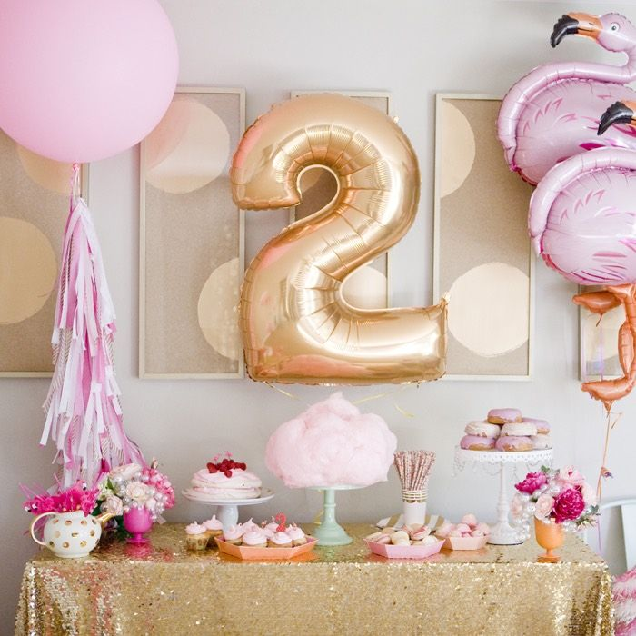 Flamingo themed birthday party via Kara's Party -- love the flamingo balloons and the tablecloth