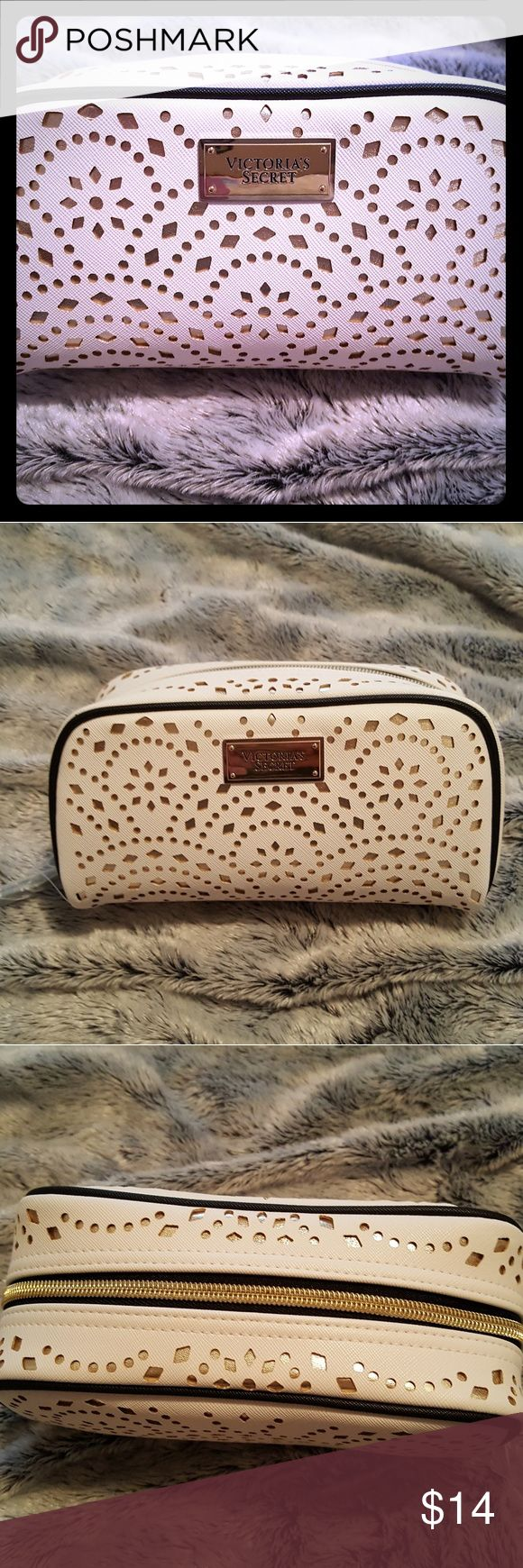 Victoria Secret small cosmetic bag!!! So cute and just the right size for your tote or your luggage!!! White cut out design over gold with black trim and goldtone hardware!!! NWOT Victoria's Secret Bags Cosmetic Bags & Cases