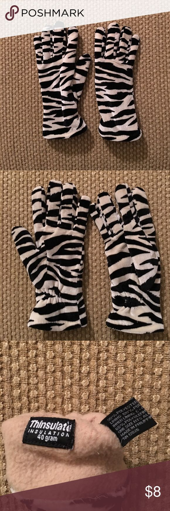Thinsulate gloves Zebra print thinsulate gloves. Great worn condition. No size listed but fits like a small. thinsulate Accessories Gloves & Mittens