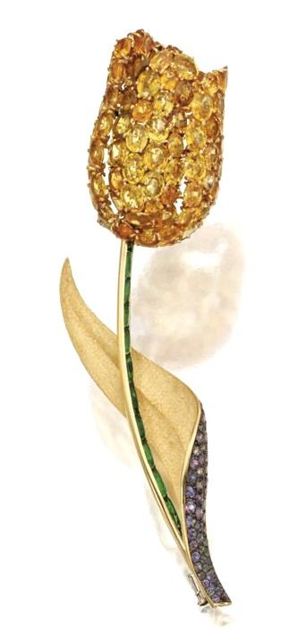 GOLD, YELLOW SAPPHIRE, TOURMALINE AND ALEXANDRITE TULIP BROOCH, MICHELE DELLA VALLE The petals set with oval yellow sapphires weighing 69.08 carats, the stem set with cabochon tourmalines, the leaf set with round alexandrites weighing 2.48 carats, signed Michele della Valle.
