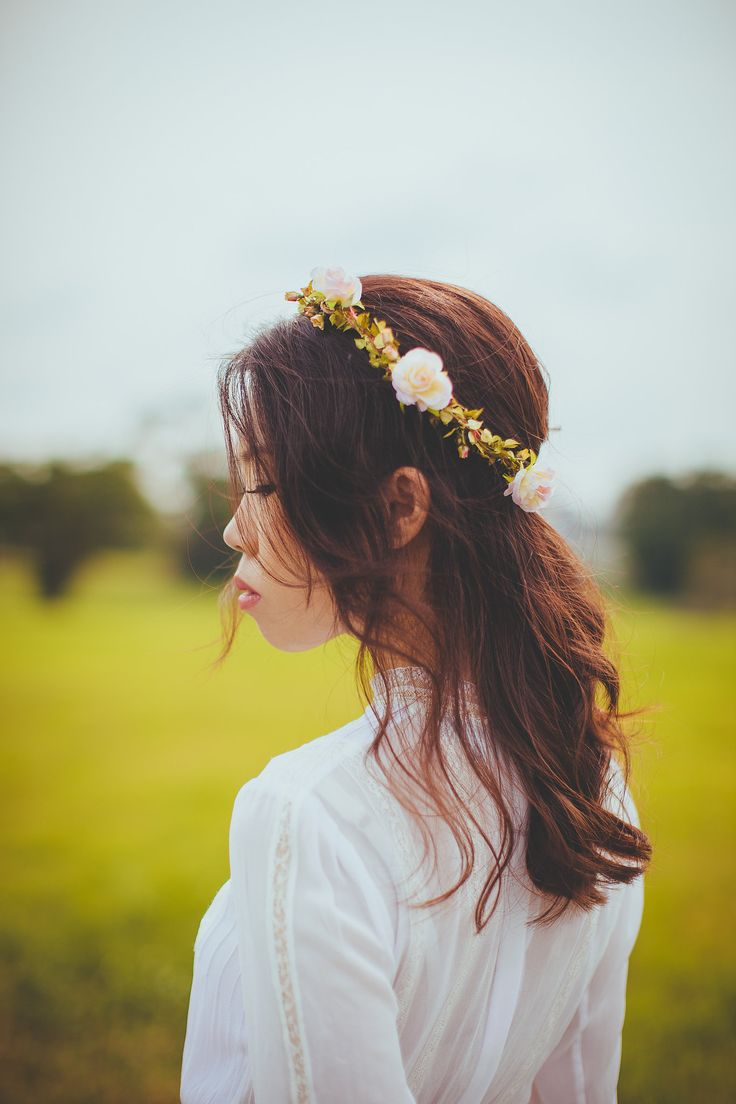 Bohemian Rustic Flowers in her hair. Photography by Jonah Sun, principal photographer of All Aflutter