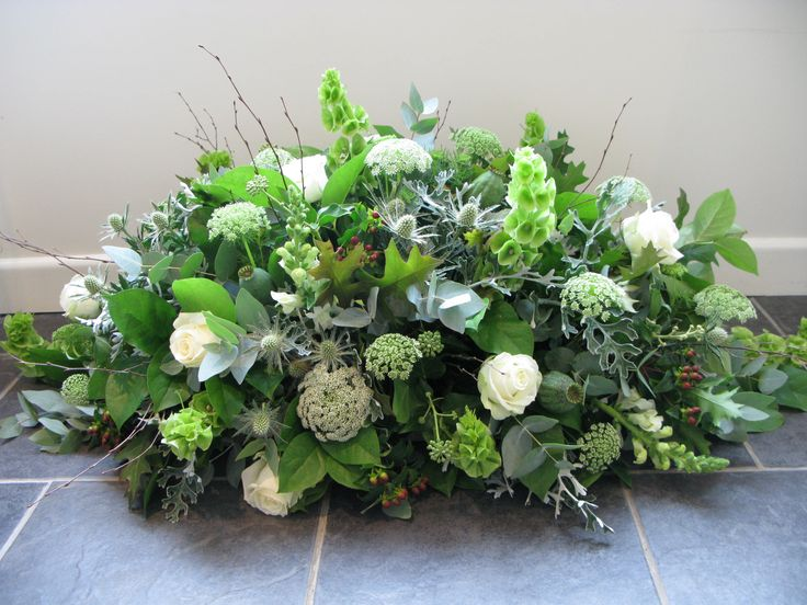 A casket with a natural feel, including thistles, cow parsley and berries.