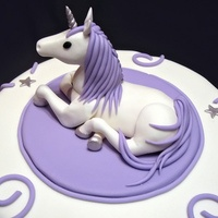 "Cake for an adult who loves unicorns. 10"" cake, topper is fondant."