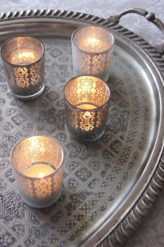 Silver tray with silver votives. Lovely.