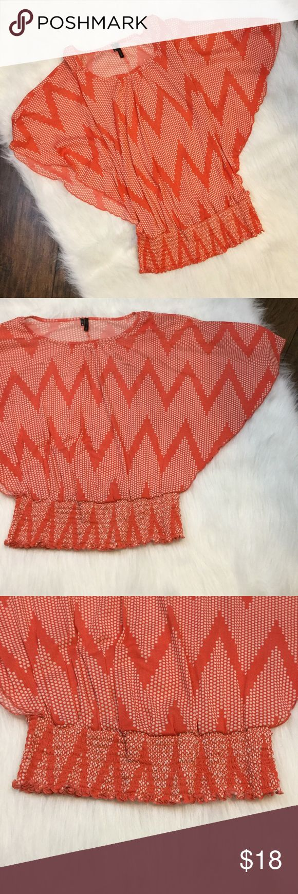 Orange and white batwing top Orange sheer batwing top with white dots that form a chevron print. Cinched bottom. The sleeves are cut all the way down to the cinched part. Maurices Tops Blouses