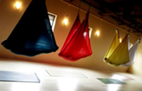Just saw a segment on 'Cocooning' - Aerial yoga is practiced with hammocks, and develops many of the same skills... (also called Anti Gravity Yoga) - it looks and sounds fantastic!