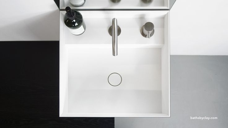 Cubic; A work of art.   Cubic is defined by its precise linear lines and sculptural presence. Available as top mounted basin or freestanding monolith. Seamlessly made from HI-MACS® Solid Surface. With its minimum width of 40cm it is an ideal solution for small bathrooms but also enriches bigger bathroom settings. Elegant matt white or add color by covering the Cubic in Fenix NTM.   #bathsbyclay #Cubic #madetomeasure #HIMACS #bathroomdesign #designwithoutcompromise