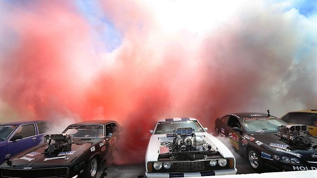 69 cars......World Record set for the most cars in a simultaneous burnout,Summernats 2013 Canberra, Australia.