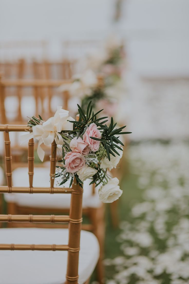 White and blush wedding chair decor // If Leonard and Rachel's Bali wedding piqued your interest yesterday, then you should definitely have a peek at Jeremy and Jessica's celebration on this tropical paradise.