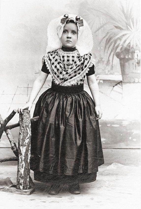 Girl in traditional Zeeland dress (Holland), c1900. Photographer: F. Machielse, Goes.