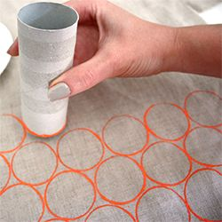 Painted dots from an empty toilet paper tube. The possibilities are endless! Maybe green and red dots on a lovely burlap for a Christmas table runner? Or blue and silver?