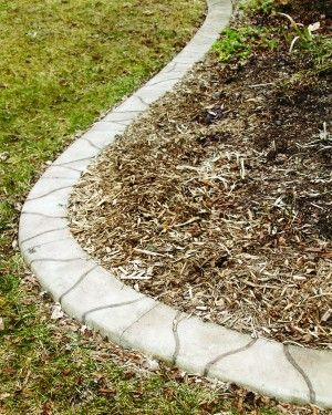 A new trend in landscaping is concrete edging that looks like flagstone.